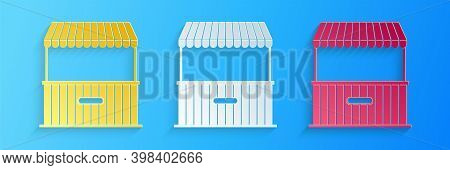 Paper Cut Street Stall With Awning And Wooden Rack Icon Isolated On Blue Background. Kiosk With Wood
