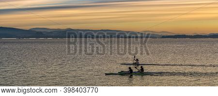 Isla De Arosa, Galicia / Spain - 1 December 2020: Young Men Training In Kayaks On The Shore Of The I