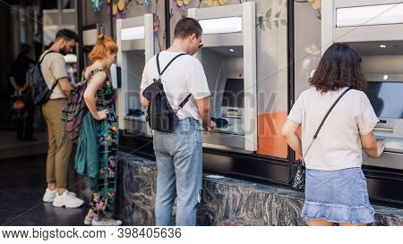 Line To Atm. Group Of People Waiting To Withdraw Money To Bank Card Using Atm Cash Machine. Bank Ser