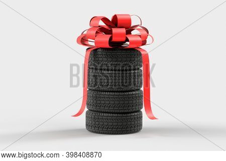 Four tires stacked on top of each other with red bow. Good graphics for a tire store, storage room, tire service. 3d illustration on white.