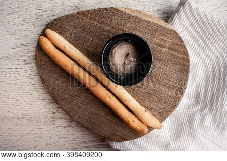 Italian Bread Stick Snack. Grizzini With Liver Pate On Wooden Board. Dipping Grissino Sticks With Di
