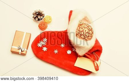 Christmas Sock White Background Top View. Small Items Stocking Stuffers Or Fillers Little Christmas