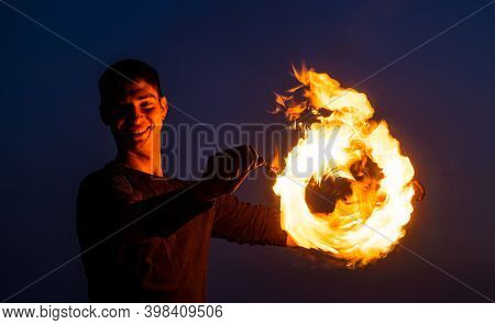 Mixing The Danger And Beauty. Fire Performer At Night. Happy Poi Performer. Burning Poi Twirling. Fl