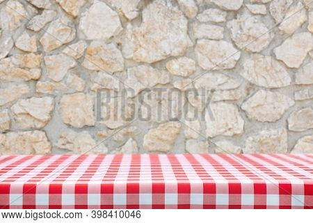 Italian Cooking Template - Blank Table With A Red Checked Tablecloth On A Old Rustic Stone Wall Back