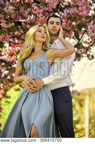 Pleasant Time Spending. Couple In Love Kiss And Embrace. Spring Flower Bloom. Man And Woman In Park