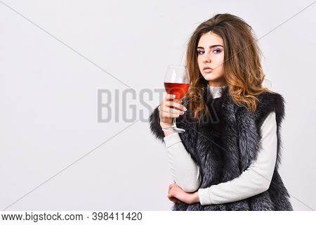 Fashion Model Long Hair Fur Coat Or Vest Hold Wineglass. Girl Enjoy Luxury Lifestyle Attributes. Wom