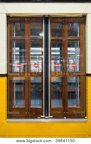 closed door of urban Milan train
