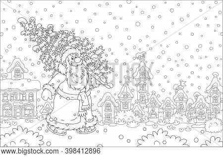 Santa Claus Walking Down A Snowy Street Of A Small Pretty Town And Carrying A Prickly Fir From A Win