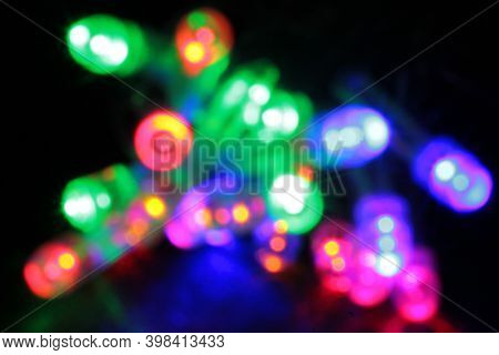 Colored lights spots on a black background
