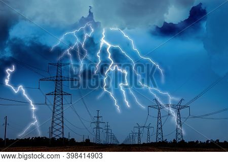 Picturesque Lightning Storm Over Field With High Voltage Towers