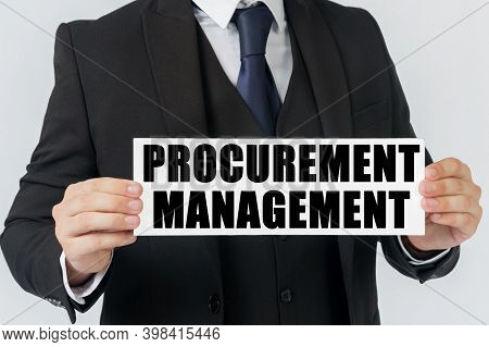 Business And Finance Concept. A Businessman Holds A Sign In His Hands Which Says - Procurement Manag