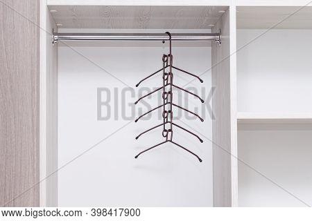 Empty Metal Multifunctional Clothes Hanger In Empty Wardrobe.