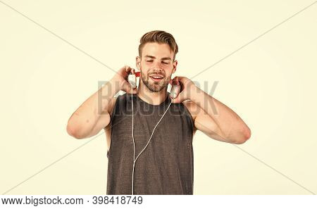 Listen Music For Motivation And Inspiration. Audio Quality. Man Handsome Unshaven Hipster Listening
