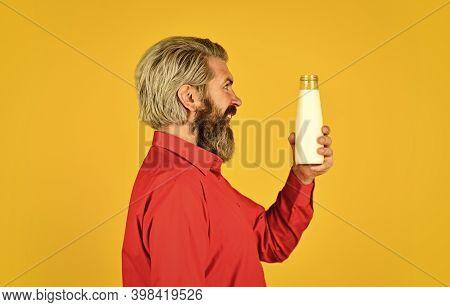 Homemade Yoghurt. Simple Tutorial For How To Make Yogurt. Bearded Man Hold Milk Bottle. Probiotic Ch