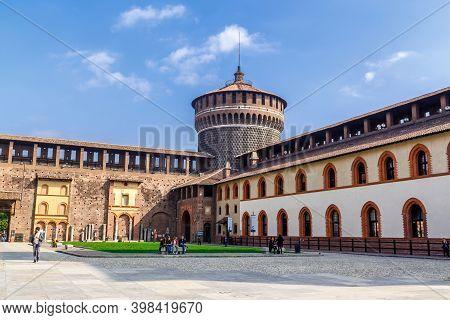 Milan, Lombardy, Italy - October 5 2017: Old Medieval Sforza Castle Castello Sforzesco, Green Lawn O