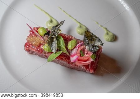 Fish Tartar With Salad. Fresh Tuna Fish Tartare With Tasty Vegetables. Delicious And Healthy Food.