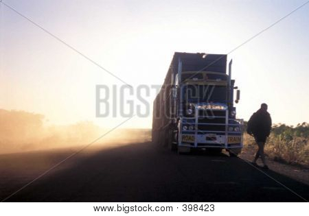 Driver And Truck Emerge From The Dust