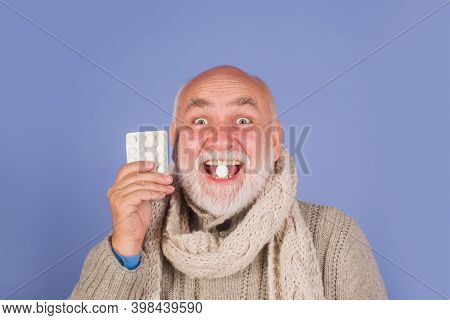 Sore Throat. Man In Scarf With Pills From Sore Throat. Treatment Pill. Medicine. Senior Man Taking P