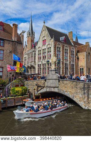 Brugge, Belgium - April 30, 2017: Tourists in old town Brugge.