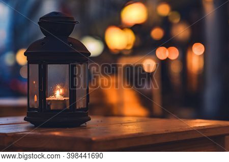Soft Focus Lantern On Table Cozy And Warm View With Orange Christmas Lights Background Festive Atmos