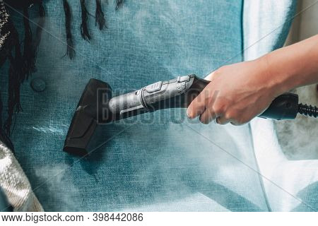 Hand Cleaning A Armchair With Steam Cleaner, Home Cleaning Conce