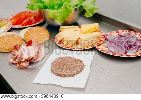 Raw Burger Cutlet. The Process Of Making A Burger In The Kitchen In A Diner.