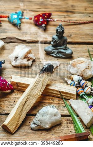 Burning Palo Santo Background With Crystals And Gemstones. Cleansing Bundle With Healing Minerals An