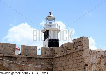 Acre, Israel - May 12, 2011: This Is The Top Of The Modern Harbor Lighthouse Outside The Old City Wa