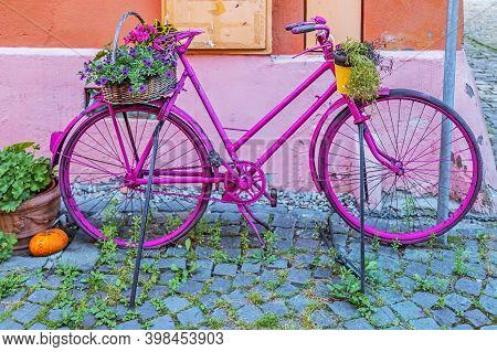 Decorative Bicycle With Flowers, On One Vintage Street In Sighisoara, Transylvania, Romania