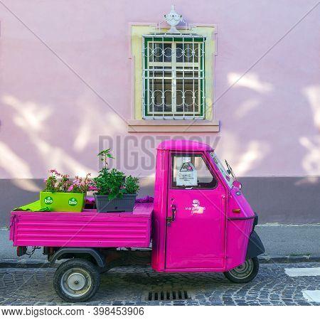 Sibiu, Transylvania, Romania - July 8, 2020: Decorative Motor Scooter With Flowers, On One Vintage S