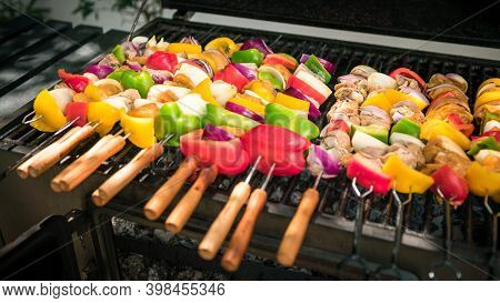 Chef Cooking Barbecue With Skewers On Grilled Meat. Very Delicious Brochette Bbq