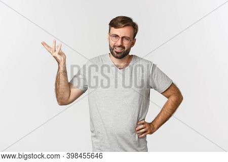 Portrait Of Handsome Adult Man Looking Confused, Raising Hand Up And Looking Perplexed, Standing Ove