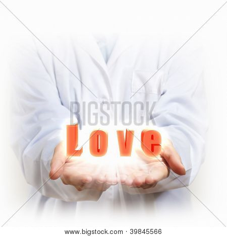 A word Love in the hand of a person