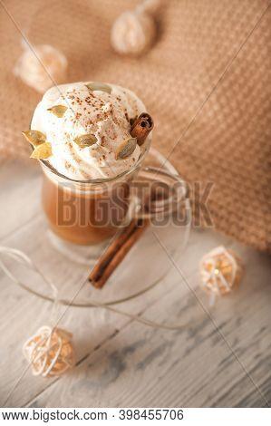 Pumpkin Latte In A Transparent Mug Close-up And Copy Space. Latte With Cream, Cinnamon, Pumpkins, Pu