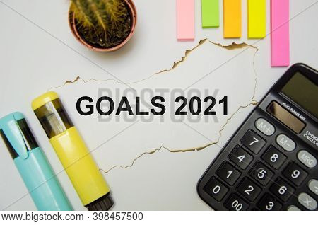 Text Goals 2021 Written On A White Background Near Calculator, Stickers, Markers, Cactus