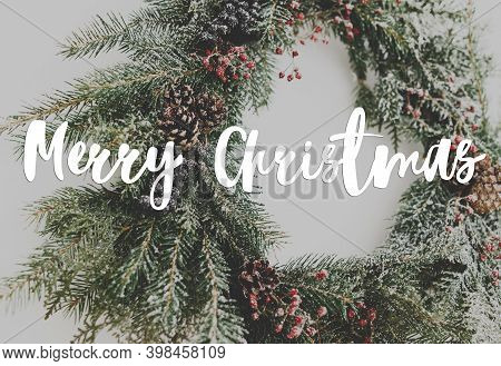 Merry Christmas Greeting Card. Merry Christmas Text Handwritten On Rustic Creative Christmas Wreath