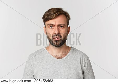 Close-up Of Handsome Confused Guy Cant Understand Something, Frowning And Looking Perplexed, Standin