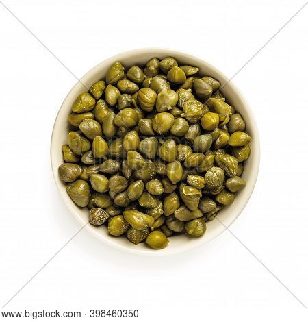 Pickled Capers In A Beige Bowl Isolated On White Background. Marinated Buds Of Caper Bush. Mediterra