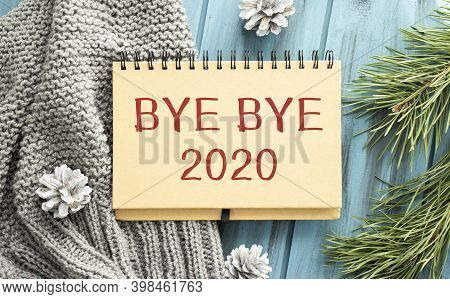 Two Green One Black Pencil With Text Bye Bye 2020 In The Notebook On The Wooden Background