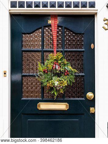 Christmas Wreath On Entrance Vintage Door Outside. Veranda Front Door Decorated By Christmas Festive
