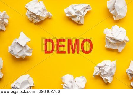 Demo Text On Yellow Background With Copy Space. Crumpled Sheets Of Paper Lie Around. Business Concep