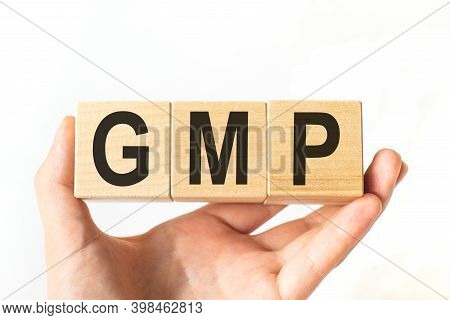 Word Gmp. Wooden Small Cubes With Letters Isolated On White Background With Copy Space Available