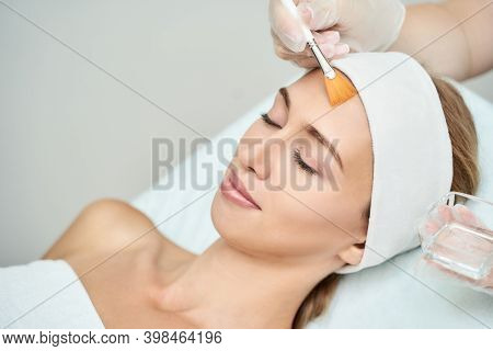 Cosmetology Beauty Procedure. Young Woman Skin Care. Beautiful Female Person. Rejuvenation Treatment