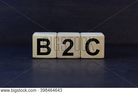 B2c Symbol. Concept Word 'b2c - Business To Customer' On Cubes On A Beautiful Dark Wooden Background