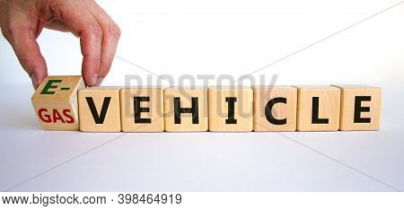 Gas Vehicle Or E-vehicle. Hand Turns A Cube And Changes Words 'gas Vehicle' To 'e-vehicle'. Beautifu