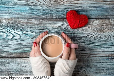 Hands Of A Woman Holding A Cup Of Coffee With Milk On A Romantic Background.