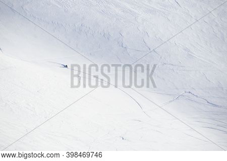 Male Freeride Skier In Northern Mountains In Lapland At Sunny Day Riding Off Piste Far Away View