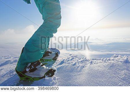 Snowboarder Riding On Slope At Ski Resort At Sunny Day