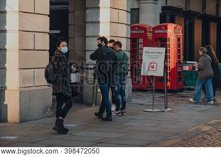 London, Uk - November 19, 2020: People Queueing To Pick Up Orders Outside Apple Store In Covent Gard