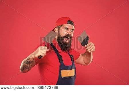 Successful Renovation. Bearded Man Worker With Plastering Tools. Plasterer Hipster Builder In Cap Re